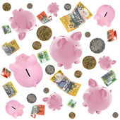 Piggy Banks and Australian Money Falling over White — Stock Photo