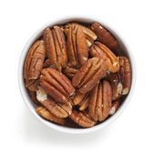 Pecans in Bowl over White Overhead View — Stock Photo