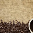 Coffee Beans and Cup over Burlap - Stock Photo