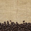 Coffee Beans Border over Burlap — Stock Photo