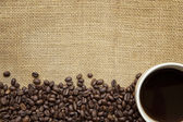 Coffee Beans and Cup over Burlap — Stock Photo