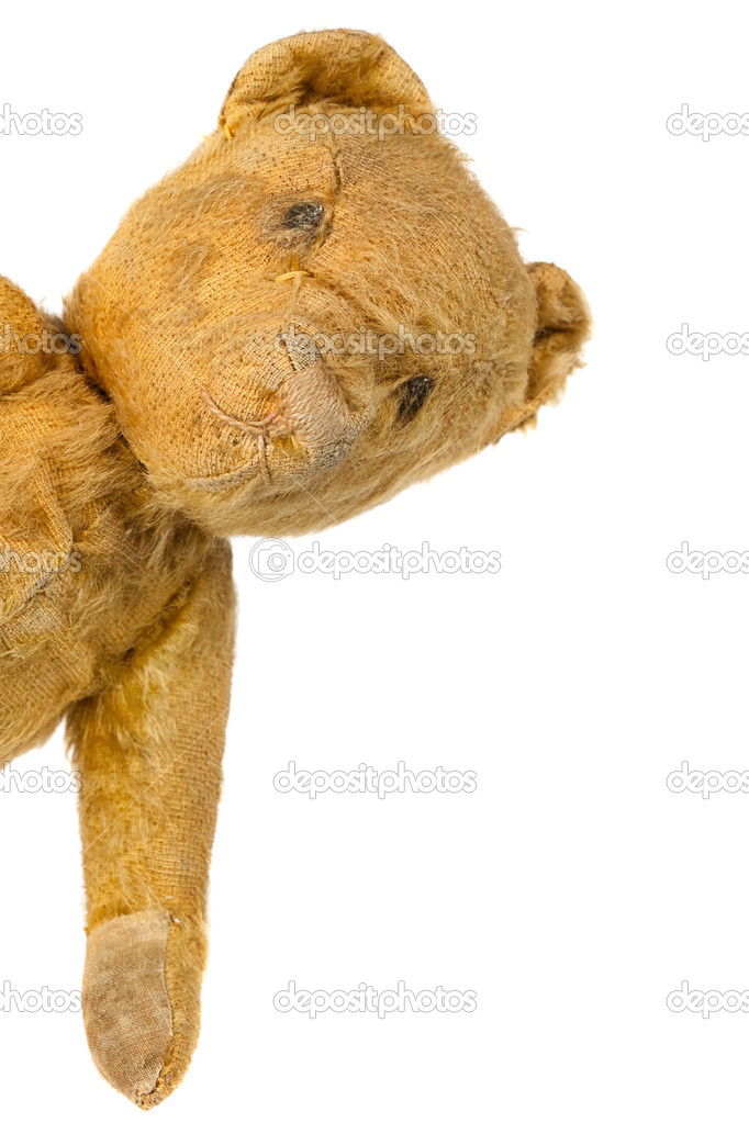 Vintage teddy bear peeking around a corner, over white background. — Stock Photo #11395814