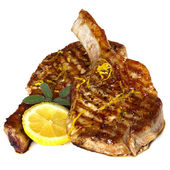 Grilled Pork Chops with Sage and Lemon over white — Stock Photo