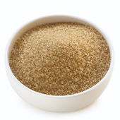 Bowl of Raw Sugar over White — Stock Photo