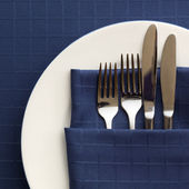 Place Setting with Blue Napkin — Stock Photo
