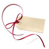 Kırmızı kurdele ile boş hediye etiketi — Stok fotoğraf