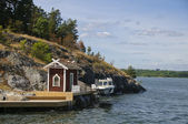 Swedish red cottage on a small island — Stock Photo