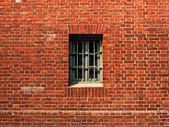 The window in a the prison wall — Stock Photo