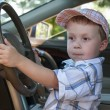 The baby at steering wheel — Stock Photo