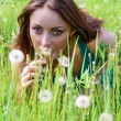 Beautiful woman with dandelions — Stock Photo
