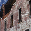 Fire Damaged Brick Building - Stockfoto