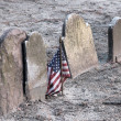 American flag and old gravestones — Stock Photo