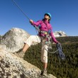 Female climber rappellling. — Stock Photo