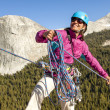 Female climber rappellling. — Stock Photo #11255575