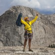 Climber celebrates on the summit. — Stock Photo