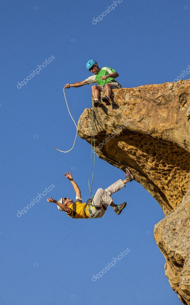 Falling climber saved by his partner. — Stock Photo ...