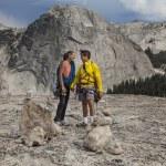 Loving climbing couple on the summit. — Stock Photo #11701311