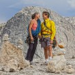Loving climbing couple on the summit. — Stock Photo