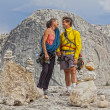 Loving climbing couple on the summit. — Stock Photo #11703386