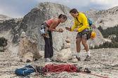 Loving climbing couple on the summit. — Stock Photo