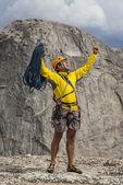 Climber celebrates on the summit. — Stock Photo