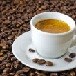 Stock Photo: Fresh espresso at roasted coffee beans