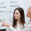 Stock Photo: Two teachers consider formula