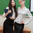 Two teachers in classroom — Stock Photo