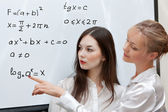 Two teachers consider formula — Stock Photo