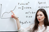 Teacher shows graphic on white board — Stock Photo