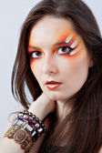 Woman with fantasy red makeup — Stock Photo