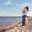 Royalty-Free Stock Photo: Couple kissing on beach