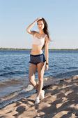 Beautiful woman on beach — Stock Photo