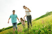 Happy family having fun outdoors — Foto de Stock
