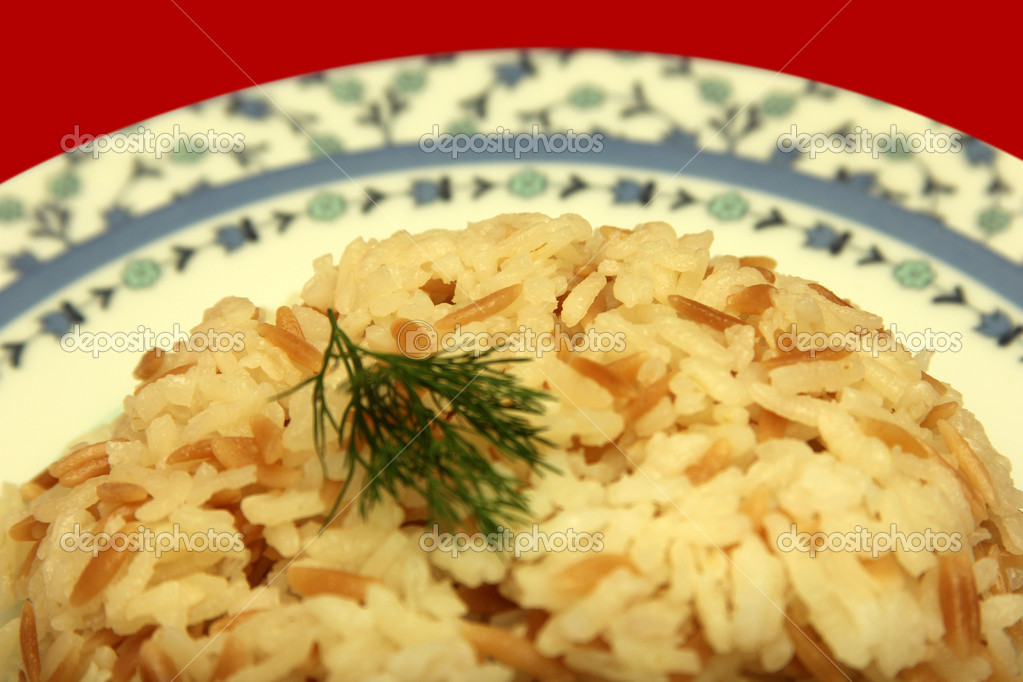 Delicious rice pilaf with meat, close-up  Stock Photo #11402437
