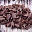 图库照片: Curly pieces of milk chocolate