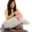 Young asian woman holding pillow — Stock Photo #11213613