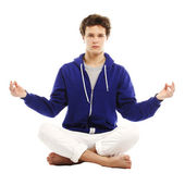 Barefoot handsome man in yoga position — Stock Photo