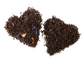 Earl Grey and Lady Grey black loose tea leaves in heart shape, i — Stock Photo