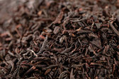 Earl Grey black loose tea leaves background, shallow dof — Stock Photo