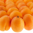 Stock Photo: Apricots background partly isolated on white, full frame, shallo