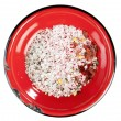 Stock Photo: Seasoned sesalt in enamel red plate, isolated