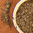 Royalty-Free Stock Photo: Zaatar-  a blend of herbs, sesame seeds and salt in an old ename