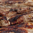 Seasoned pork chops ribs on a bbq — Stock Photo