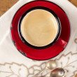 Stock Photo: Espresso coffee in red enamel mug, two old silver spoons, embroi