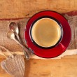 Espresso coffee, red enamel mug, two old silver spoons, two wood — Stock Photo #12347985