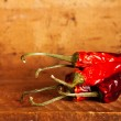 Stock Photo: Hot red chillies paper bunch inside wooden case