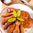 ������, ������: Homemade smoked chicken drumsticks and thighs on a plate