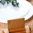 Aromatic place card with holly twig in white plate — Stock Photo #12348197