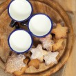 Homemade gingerbread  star cookies with three kids milk on woode - Stock Photo